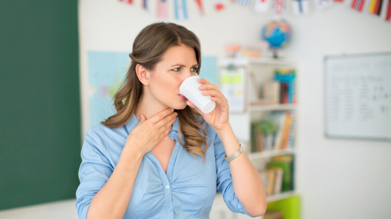 Woman drinking water struggling with dysphagia, or, difficulty swallowing.
